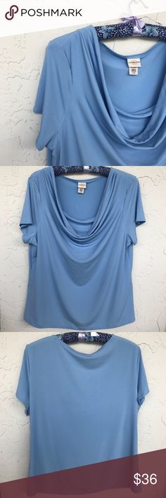 🆕Lovely Draped Neck Top Blue EUC Beautiful scoop neck top with draped overlay. Hangs so beautifully! Lovely shade of light periwinkle blue – difficult to capture in photo, but one that will capture hearts! Perfect under a jacket or on its own anytime! Lightweight polyester with a touch of spandex for that great fit! Beautifully draped neckline with double front and short sleeves. Gently pre-loved, only one small pull which isn't noticeable as it falls within the folds of the draped cowl…
