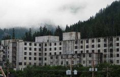 The Bizarre and The Curious https://www.facebook.com/TheBizarreAndTheCurious  Buckner Building, Whittier, AK - was built in 1953 included a movie theater, a bowling alley and a jail. Tunnels lead from the building to other parts of the small, haunted town. Strange sounds fill the building, and many can be attributed to wind or animals scurrying about, but not all. Some noises and events remain unexplained.