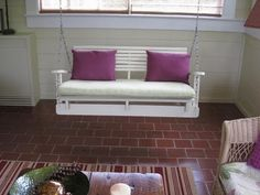 Porch swing. Repurposed wood/pallet. Link to instructions not found.