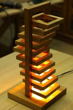 A stylish wooden cube lamp is made of natural wood by hand. It will serve as a decoration of your interior, and also help create a warm atmosphere of comfort in the evening. Into The Woods, Wooden Lamp, Wooden Chairs, Diy Holz, Wood Design, Wood Furniture, Wood Art, Lighting Design, Wood Projects