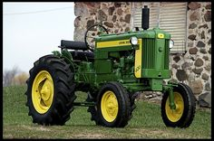 1957 John Deere 420S for sale by Mecum Auction $11,250 high bid - Very rare option of direction reverser. The direction reverser allows the use of any forward gears while backing up