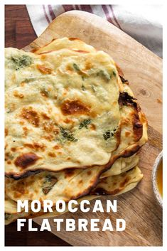 Msemen (Moroccan Flatbread): A popular Moroccan flatbread, msemen (or m'smen) is made by folding the dough over itself to make layer upon flaky layer. This version is flavored with fresh mint and dipped into honey-butter. Moroccan Bread, Morrocan Food, Moroccan Dishes, Moroccan Party Food, Indian Food Recipes, Vegetarian Recipes, Cooking Recipes, Moroccan Food Recipes, Moraccan Recipes