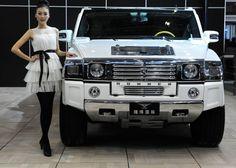 Asian chicks sure do love white vehicles.