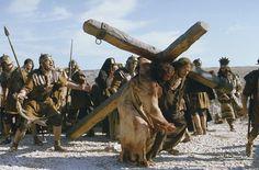 The Passion of the Christ-Simon of Cyrene (Jarreth Merz) helps Jesus (Jim Caviezel) carry his Cross.