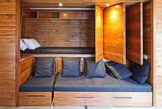 Beach Style Bedroom by First Light Studio This wall folds back to reveal a spare bed (double) for overnight guests.  Normally it is the back of the Lounge room couch.