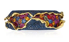 An unusual suite of coloured diamond and coloured sapphire 'Craquele' jewellery, by Andre Marcha. Comprising a hinged bangle, ear clips and a ring