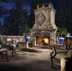 Enjoy your outdoor space with all the amenities. This beautiful patio features an outdoor fireplace, grill, and seating area. The perfect place to entertain. #HarmonyOutdoorLiving @Belgard Hardscapes