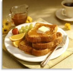 Buttered toast with assorted fruit on the side.