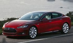 A three-quarter front view of a red 2012 Tesla Model S