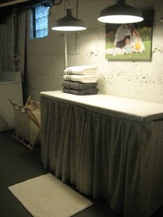 Basement laundry room folding table which could also be used as ironing board.