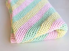 This corner to corner baby blanket pattern is a great way to use up leftover yarns in your yarn stash. Knit in three colours you can keep the stripes or knit in only one colour. A lovely soft squishy baby blanket for those cuddle time naps! get the free pattern and see how you can get started. #babyblanket #c2c #cornertocorner #blanket #knitblanket Easy Blanket Knitting Patterns, Knit Patterns, Knitting Ideas, Knitting Projects, Bernat Baby Blanket, Knitted Baby Blankets, Baby Afghans, Baby Knitting, Crochet Baby