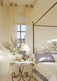 Interesting way to hang curtains! We also love the color combination of cream and lavender.