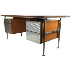 Iconic Modernist Executive Desk by Welton Becket | From a unique collection of antique and modern desks and writing tables at https://www.1stdibs.com/furniture/tables/desks-writing-tables/