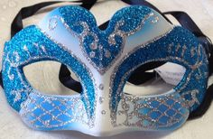 This petit sparkle design blue and white venetian style masquerade mask is new. This mask is ribbon tie concept to create a comfortable fit and great to reuse if needed. This mask is 8 inches across and 3 inches high #reflections_vintage_toronto #masks #masquerade #masqueradeball