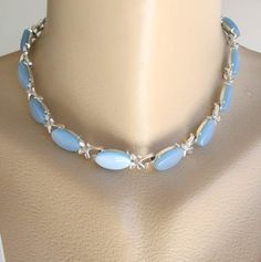 This necklace has luminescent, blue moonglow lucite links, with the ends of each link having small loops and two tiny leaves. The necklace is long with a hook clasp. The hook is marked and hard to 60s Jewelry, Plastic Jewelry, Jade Jewelry, Art Deco Jewelry, Vintage Costume Jewelry, Antique Jewelry, Vintage Jewelry, Jewelry Design, Jewish Jewelry