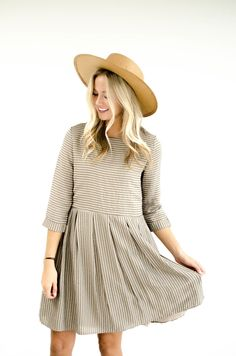 """Olive + Taupe Stripe Dress Round Neck w/Keyhole Back Hidden Seam Pockets Rolled Half Sleeves Gathered Waist Fully Lined View Size Chart Model is 5'9"""" + Wearing a Small"""