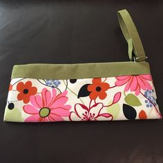 One of a Kind - Floral print wristlet One of a Kind - Floral print wristlet with chartreuse suede accent & strap. Custom created by Carmelita Starr. One small spot on bag as shown in photo. Only used twice, great condition. Bags Clutches & Wristlets