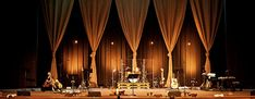 Jake Wandel from The Crossingin Columbia, MO brings us this design inspired by Pinterest. Each curtain was 2 sections of 4ft wide burlap hung at the top using zip ties and safety pins (burlap is s...