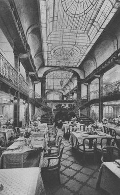 The cavernous First Class Salle a Manger (Dining Room) of the Paris, flagship of the Compagnie Générale Transatlantique/The French Line. 1916. According to my Maternal Great Grandmother's notes on the back of this card, written in her elegant script, her favourite table was the one on the left, immediately off that magnificent Staircase, back to pillar, facing into the chamber. From the private collection of John Cunard-Shutter.
