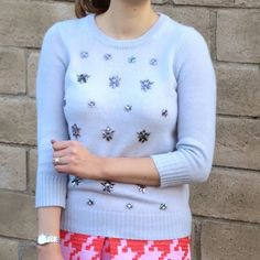 J. Crew Jeweled-Cluster Sweater J. Crew Jeweled-Cluster Sweater in lavender.  -Polyacrylic/wool/mohair in a 7-gauge knit. -Three-quarter sleeves. -Rib trim at neck, cuffs and hem. -Semifitted.  -Hits at hip. -Excellent condition! *cover photo from hellokatiegirl blog   NO Trades. Please make all offers through offer button. J. Crew Sweaters