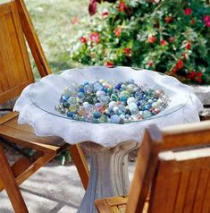 Most items are created with a particular use in mind; part of integrating whimsical landscaping design ideas is to turn that use on its head. A birdbath becomes a spot to display a colorful collection of marbles. Covered with a piece of plastic or glass, the structure is a conversation piece that doubles as a small table. #landscapingdesignideas