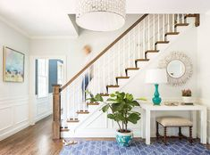 Today, I am happy to share this beautiful renovated home with coastal interiors, designed by the very talented Jamie Keskin Design.    This home is full of great coastal interior ideas. A soft color palette reminds you of calm days at the beach while cheerful colors are perfectly combined with elegant and subtle elements. A white kitchen with a gray island brings this home to a higher level.  The master bedroom is yet another room that doesn't