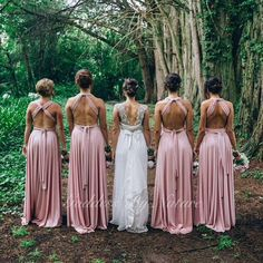 Stunning & breathtakingly back shot of beautiful bride @sarah_tilse with her gorgeous bridesmaids wearing their Goddess By Nature signature multiway ballgowns worn with a sexy high knotted back in the amazing dust me pink colour that's so popular for bridal parties   @kieranmoorephotography  Stockists WhiteRunway.com  www.goddessbynature.com info@goddessbynature.com For your nearest stockists worldwide  #goddessbynature #goddessbynaturedress #bridesmaids #bride #bridesmaidsdress #wedding #mu