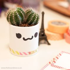 An espresso cup and skinny washi tape make a really cute pot for a mini cactus :)