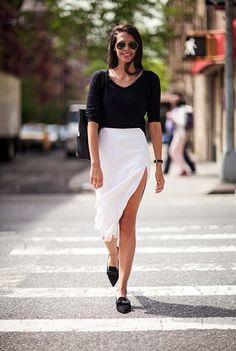 Classy black bodysuit tucked in to white summer skirt.