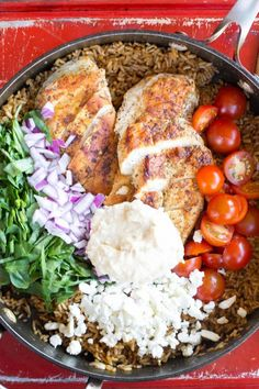 I absolutely love Mediterranean flavors like what's in this One Pot Greek Chicken and Rice recipe! Garden fresh tomatoes, hummus and perfectly seasoned chicken topped with feta cheese will have the family asking for more Greek food! | OHMY-CREATIVE.COM #dinnerrecipes #greek #recipe