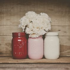 Valentines day decor painted mason jars. Pink and red.