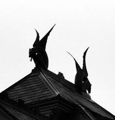 Black gargoyles on roof.
