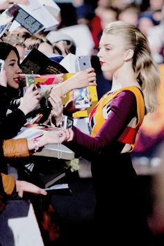 Natalie Dormer signs fan autographs at the Berlin World Premiere of The Hunger Games Mockingjay, Part 2, on the 4th of November, 2015.