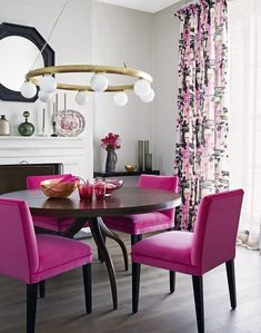 Neutral dining room with bright pink chairs