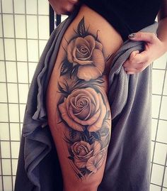 A stunning thigh rose inspired sexy tattoo idea!