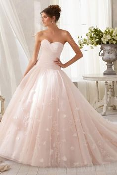 I totally wish that I had followed my childhood dream and wore a blush pink wedding dress!