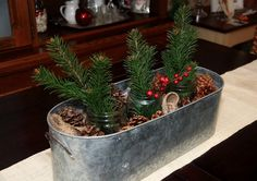 Furniture and Accessories. Lovely Minimalist DIY Rustic Christmas Centerpiece with Nice Pinecones, Faux Branches, Burlap, Mason Jars, and Cool Galvanized Planter from Backyard. Fresh Natural Greenery for Simple yet Beautiful Christmas Centerpieces Christmas Tree Table Decorations, Christmas Tree On Table, Christmas Centerpieces, Rustic Christmas, Christmas Crafts, Christmas Printables, Christmas Décor, Elegant Christmas, Christmas Ornaments