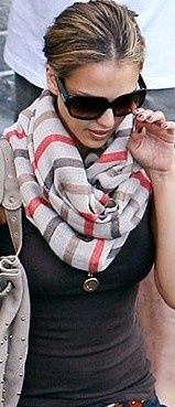 "Click to see ""How to tie your scarf like a Parisian""."