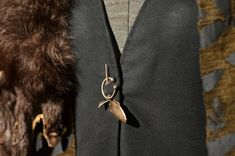 """Costume designer Michele Clapton purposefully chose not to give the Starks jewelry, to reflect the harsh, practical nature of life in the north. The one exception to this rule was Catelyn's trout pin, the sigil of her family, House Tully. 