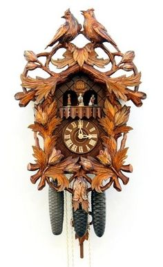 Model #4571 Beautiful Hand-carved Black Forest Cuckoo Clock by Romba & Haas    This cuckoo clock is an example of the finest carving available. This is a large clock with excellent four large, full-depth carvings of birds surrounded by leaves and budding flowers.