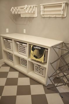 laundry room folding station with drying rack that folds in and out