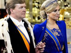 """King Willem-Alexander and Queen Maxima  are leaving """"De nieuwe kerk"""" after Willem's inauguration 4/30/13."""