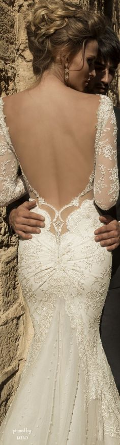 I think this is probably one of the most sexiest wedding dresses I have ever seen. Love the low cut back...............