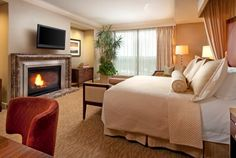 A fireplace in the hotel suite! Romantic hotel in Houston | St. Regis Houston Hotel - Presidential Suite Master Bedroom