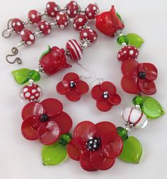 Gorgeous Red Open flowers and Buds, along with Red and White accent beads.