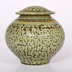 Tom Turner (1947; USA) Covered Jar  ca 1977. Fake ash glazed porcelain, ht. 5.5, dim. 5.5 in. Artist signature on base. A beautifully thrown ash glazed lidded vessel.
