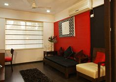 Red Black & White. Perfect combo for the sit up area by Puran Interiors