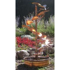 """This six-foot tall, leafy, hand-crafted copper fountain is a great accent to """"plant"""" in your yard or garden, or near a relaxing patio."""