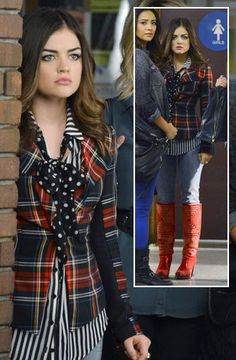 Aria wearing plaid blazer with red boots, striped blouse and polka dot scarf tied in a bow.