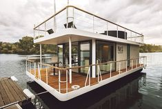 This is the Living Houseboat by Living. It's a modern houseboat with a wrap around deck and an additional rooftop deck. Inside, you'll find a bedroom, living area… Pontoon Houseboat, Houseboat Living, Houseboat Ideas, Pontoon Boat, Boat Dock, Floating Architecture, Sustainable Architecture, Residential Architecture, Contemporary Architecture
